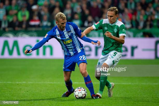 Fabian Lustenberger of Hertha BSC and Ludwig Augustinsson of Werder Bremen battle for the ball during the Bundesliga match between SV Werder Bremen...