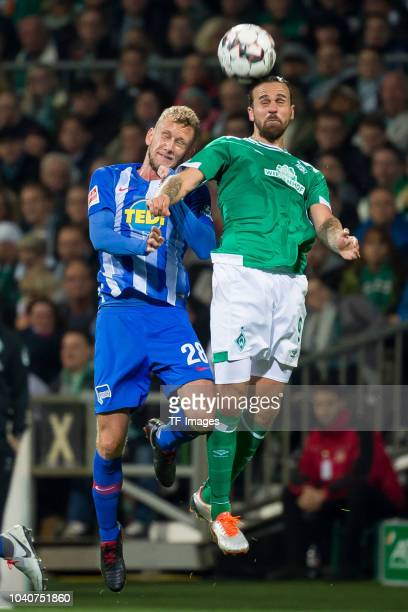Fabian Lustenberger of Hertha BSC and Martin Harnik of Werder Bremen battle for the ball during the Bundesliga match between SV Werder Bremen and...