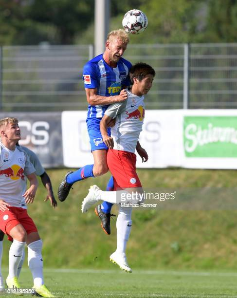 Fabian Lustenberger of Hertha BSC and Masaya Okugawa of FC Liefering during the game between FC Liefering against Hertha BSC at the Athletic Area...