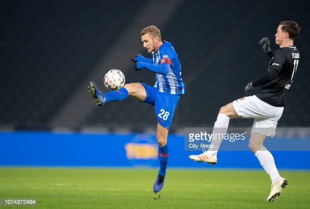 Fabian Lustenberger of Hertha BSC and Michael Gregoritsch of FC Augsburg during the Bundesliga match between Hertha BSC and FC Augsburg at...