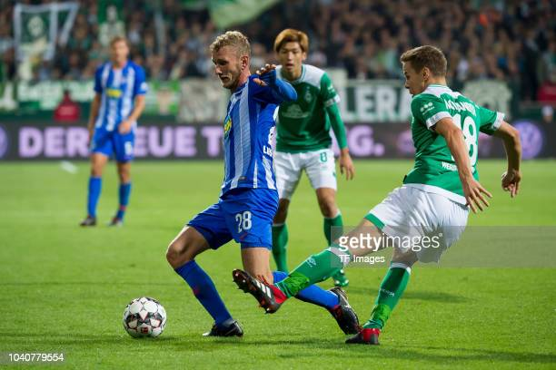 Fabian Lustenberger of Hertha BSC and Niklas Moisander of Werder Bremen battle for the ball during the Bundesliga match between SV Werder Bremen and...