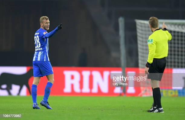 Fabian Lustenberger of Hertha BSC and referee Tobias Welz during the Bundesliga match between Hertha BSC and TSG Hoffenheim at Olympiastadion on...