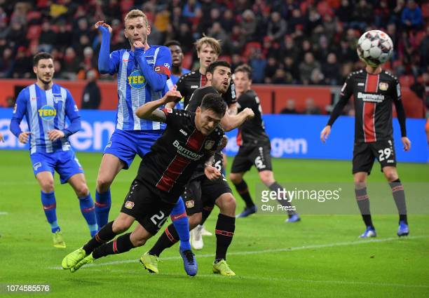 Fabian Lustenberger of Hertha BSC Charles Aranguiz and Kevin Volland of Bayer 04 Leverkusen during the Bundesliga match between Bayer 04 Leverkusen...