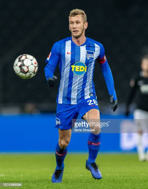 Fabian Lustenberger of Hertha BSC controls the ball during the Bundesliga match between Hertha BSC and FC Augsburg at Olympiastadion on December 18...