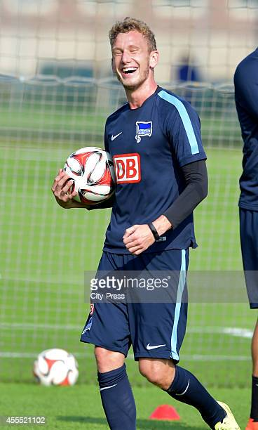 Fabian Lustenberger of Hertha BSC laughs during the Training of Hertha BSC on September 16, 2014 in Berlin, Germany.