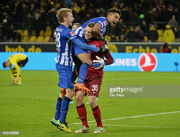 Fabian Lustenberger , Sami Allagui and Marius Gersbeck celebrate during the Bundesliga game between Borussia Dortmund and Hertha BSC on december 21,...