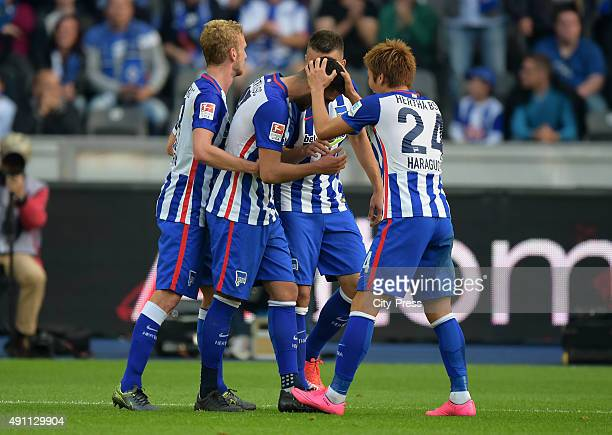 Fabian Lustenberger Tolga Cigerci Vedad Ibisevic and Genki Haraguchi of Hertha BSC celebrate after scoring the 20 during the Bundesliga match between...