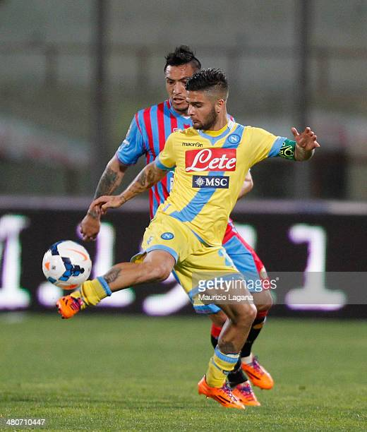Fabian Monzon of Catania competes for the ball with Lorenzo Insigne of Napoli during the Serie A match between Calcio Catania and SSC Napoli at...
