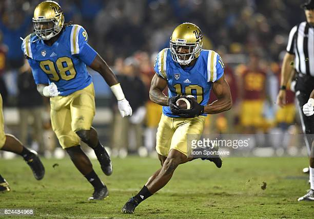Fabian Moreau intercepts a pass and runs the ball during an NCAA football game between the USC Trojans and the UCLA Bruins on November 19 at the Rose...