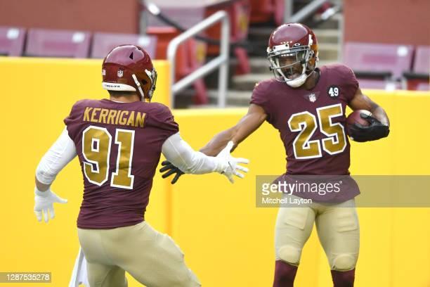 Fabian Moreau of the Washington Football Team celebrates a play with Ryan Kerrigan a NFL football game against the Washington Football Team on...