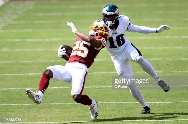 Fabian Moreau of the Washington Football Team intercepts a pass in the second quarter against Jalen Reagor of the Philadelphia Eagles at FedExField...