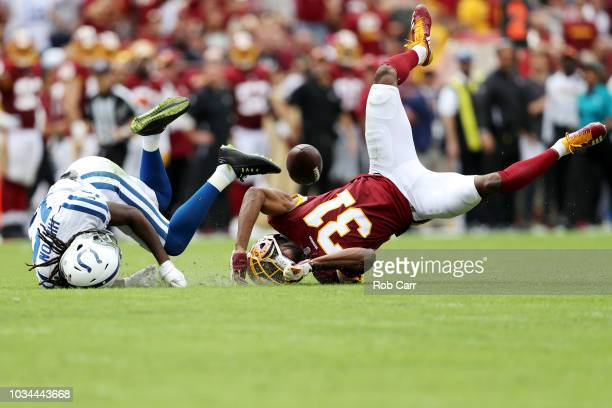 Fabian Moreau of the Washington Redskins breaks up a pass intended for TY Hilton of the Indianapolis Colts and was called for pass interference on...