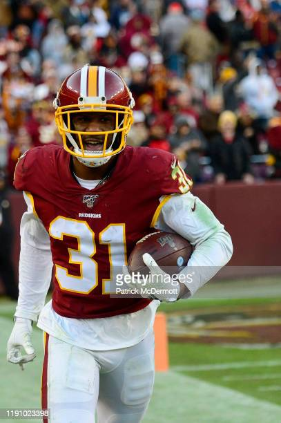 Fabian Moreau of the Washington Redskins celebrates after intercepting a pass by Jeff Driskel of the Detroit Lions in the fourth quarter at...