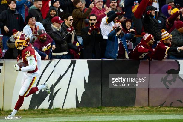 Fabian Moreau of the Washington Redskins celebrates with fans after intercepting a pass by Jeff Driskel of the Detroit Lions in the fourth quarter at...
