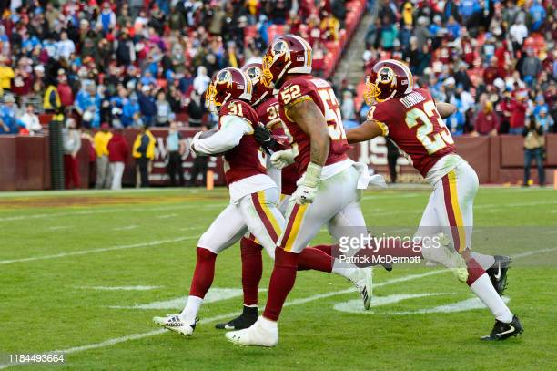 Fabian Moreau of the Washington Redskins celebrates with his teammates after intercepting a pass by Jeff Driskel of the Detroit Lions in the fourth...