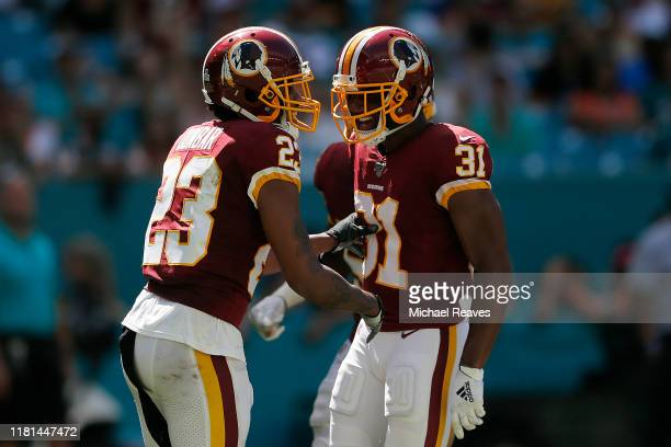 Fabian Moreau of the Washington Redskins celebrates with Quinton Dunbar after a interception against the Miami Dolphins during the second quarter at...