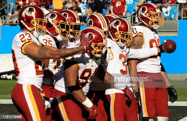 Fabian Moreau of the Washington Redskins celebrates with teammates after making an interception against the Carolina Panthers during their game at...