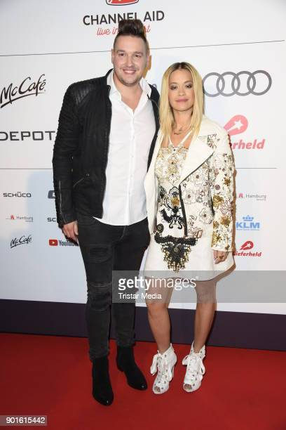 Fabian Narkus and Rita Ora attend the Channel Aid Concert at Elbphilharmonie on January 5 2018 in Hamburg Germany