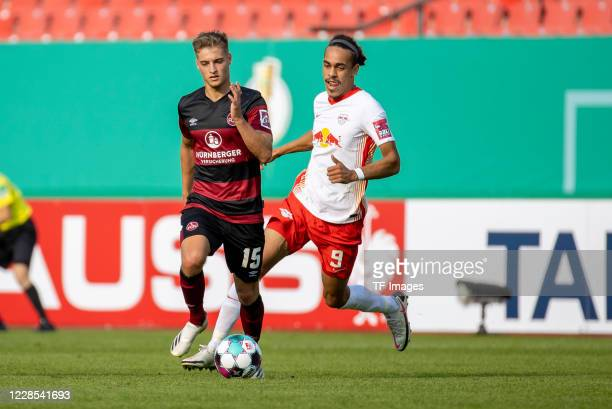 Fabian Nuernberger of 1FC Nuernberg and Yussuf Poulsen of RB Leipzig during the DFB Cup first round match between 1 FC Nuernberg and RB Leipzig at...