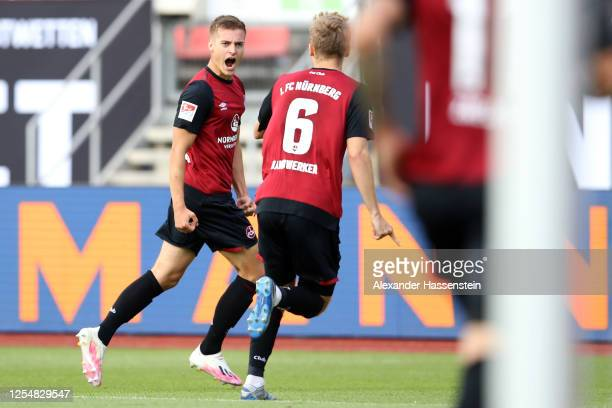 Fabian Nuernberger of Nuernberg celebrates his team's first goal with teammate Tim Handwerker during the 2 Bundesliga playoff first leg match between...