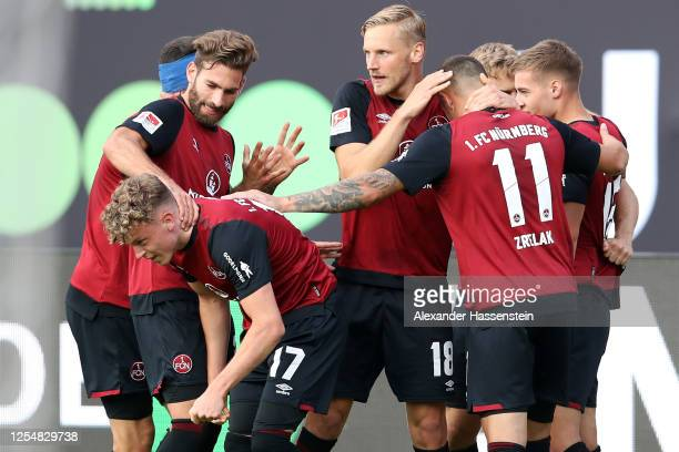 Fabian Nuernberger of Nuernberg celebrates his team's first goal with teammates during the 2 Bundesliga playoff first leg match between 1 FC Nürnberg...