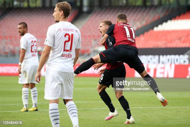 Fabian Nuernberger of Nuernberg celebrates his team's second goal with teammate Adam Zrelak during the 2. Bundesliga playoff first leg match between...