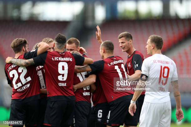 Fabian Nuernberger of Nuernberg celebrates his team's second goal with teammates during the 2 Bundesliga playoff first leg match between 1 FC...