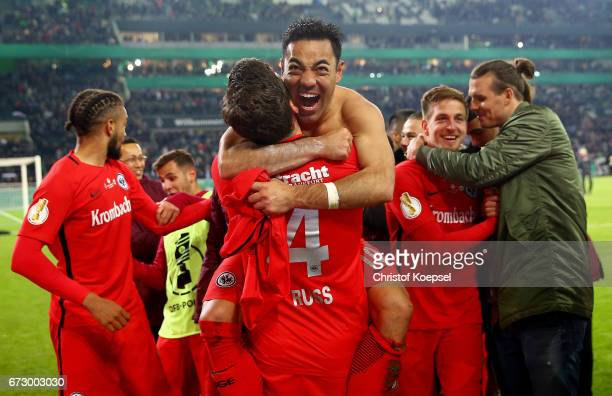 Fabian of Frankfurt celebrate with his team mates victory after penalty shoot out during the DFB Cup semi final match between Borussia...