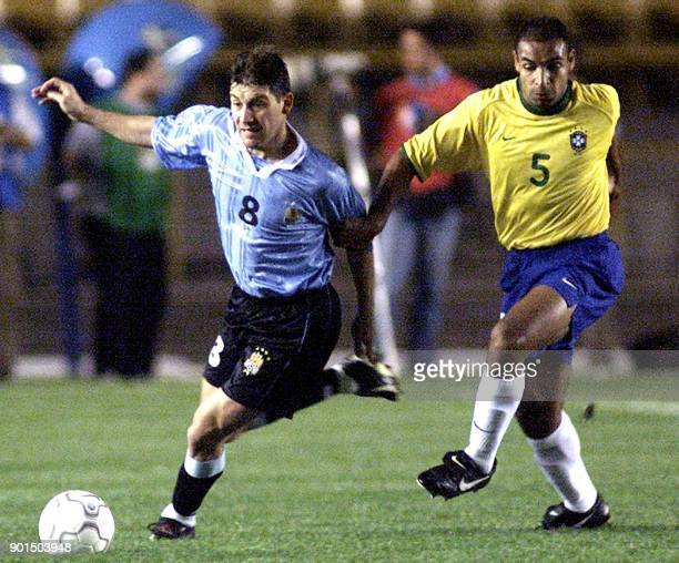 Fabian O'Neil of Uruguay fights for the ball with Emerson of Brazil during an elimination game of World Cup 2002 in Rio de Janeiro 28 June 2000 El...