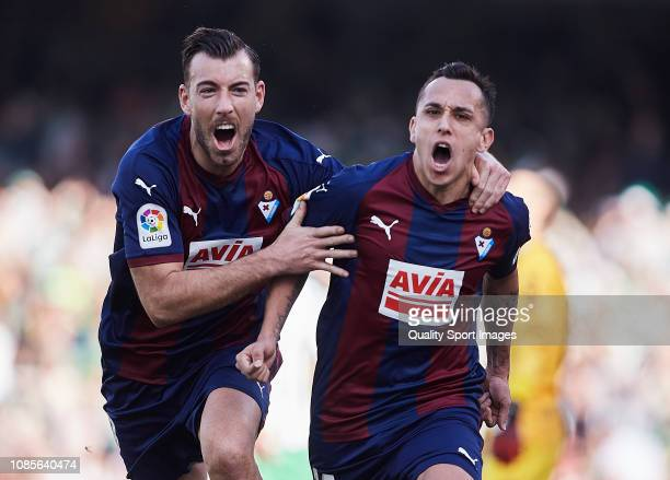 Fabian Orellana and Sergi Enrich of SD Eibar celebrate scoring their team's opening goal during the La Liga match between Real Betis Balompie and SD...