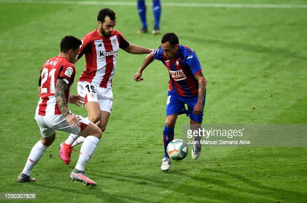 Fabian Orellana of SD Eibar battles for possession with Inigo Lekue of Athletic Club during the La Liga match between SD Eibar SAD and Athletic Club...