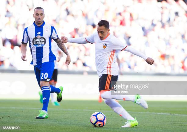Fabian Orellana of Valencia CF and Guilherme dos Santos of Deportivo de la Corua during their La Liga match between Valencia CF and Deportivo de la...