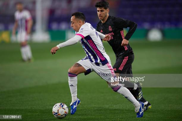 Fabian Orellana of Valladolid and Marco Asensio of Real Madrid compete for the ball during the La Liga Santander match between Real Valladolid CF and...