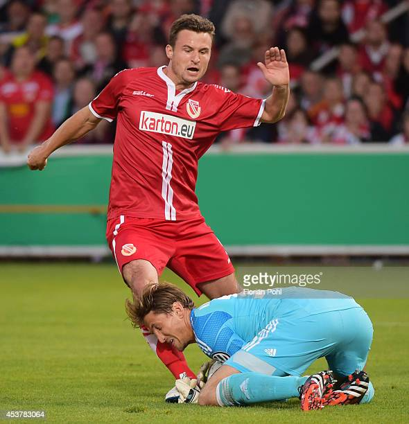 Fabian Pawela of FC Energie Cottbus battles with Rene Adler of Hamburger SV during the DFP Cup first round match between Energie Cottbus and...