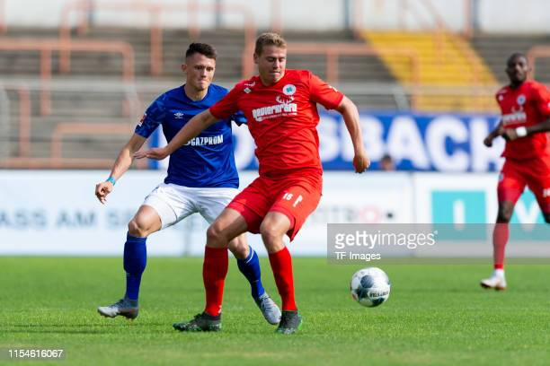 Fabian Reese of FC Schalke 04 and Maik Odenthal of RW Oberhausen battle for the ball during the preseason friendly match between RW Oberhausen and...