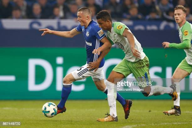 Fabian Reese of Schalke 04 Felix Uduokhai of VfL Wolfsburg during the German Bundesliga match between Schalke 04 v VFL Wolfsburg at the Veltins Arena...