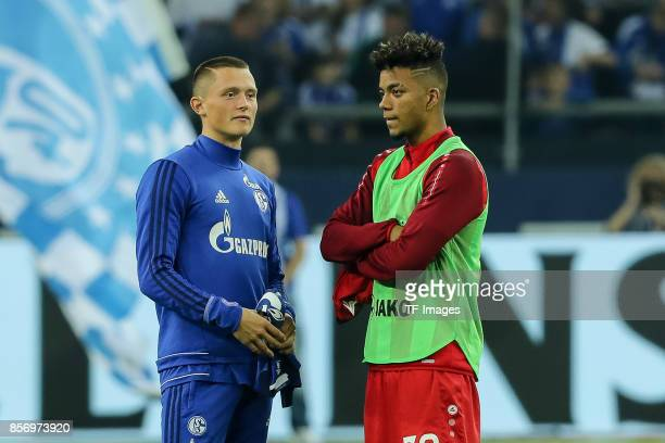 Fabian Reese of Schalke and Benjamin Henrichs of Leverkusen looks on during the Bundesliga match between FC Schalke 04 and Bayer 04 Leverkusen at...