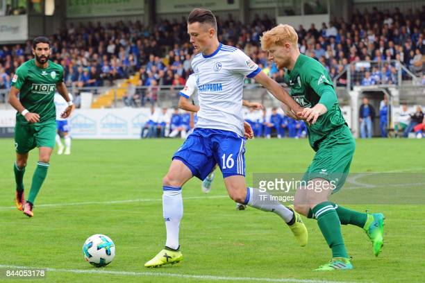 Fabian Reese of Schalke and Lars Beuckmann of Guetersloh battle for the ball during the preseason friendly match between FC Gütersloh and FC Schalke...
