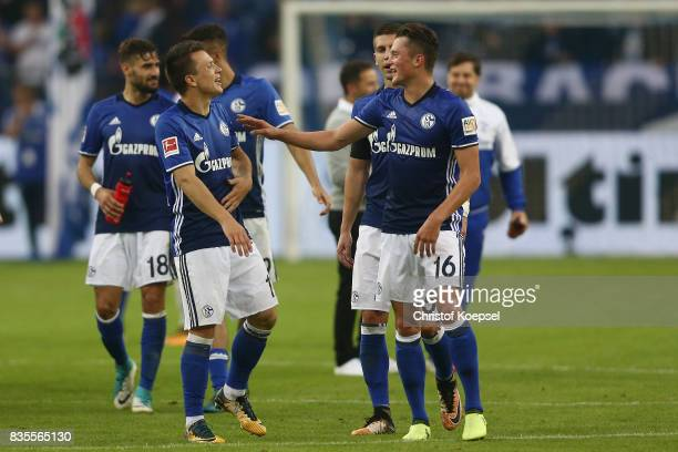 Fabian Reese of Schalke celebrates with Yevhen Konoplyanka of Schalke following their victory during the Bundesliga match between FC Schalke 04 and...