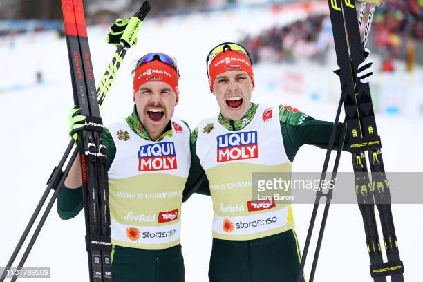 Fabian Riessle and Eric Frenzel of Germany celebrates following their victory in Team Sprint Large Hill / 2 X 75km for the Nordic Combined during the...