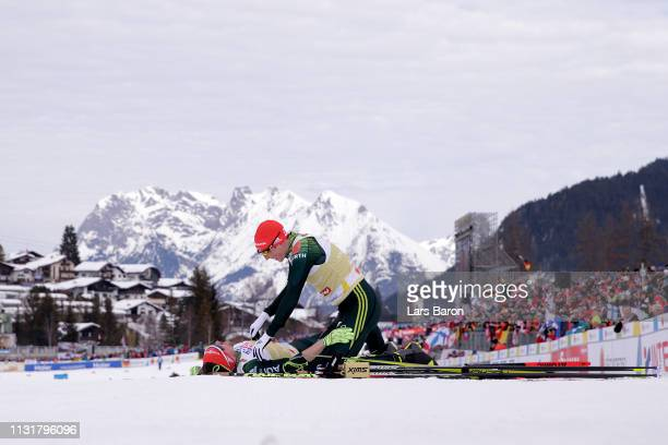 Fabian Riessle and Eric Frenzel of Germany celebrates following their victory in the Team Sprint Large Hill / 2 X 75km for the Nordic Combined during...