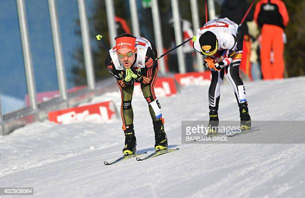 Fabian Riessle of Germany and Mario Seidl of Austria compete during the Men's Nordic Combined FIS World Cup on January 28 2017 in Seefeld Austria /...