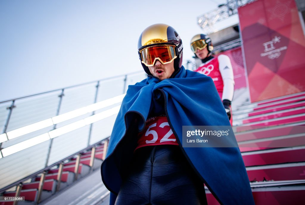 Fabian Riessle of Germany tries to keep warm at the Normal Hill during the Nordic Combined Individual Gundersen NH/10km official training on February 12, 2018 in Pyeongchang-gun, South Korea.
