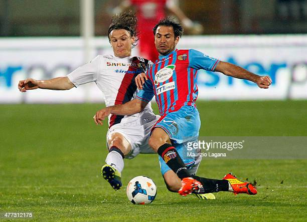 Fabian Rinaudo of Catania competes for the ball with Albin Ekdal of Cagliari during the Serie A match between Calcio Catania and Cagliari Calcio at...