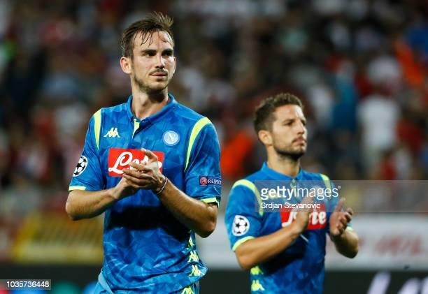 Fabian Ruiz and Dries Mertens of SSC Napoli applauds supporters after the Group C match of the UEFA Champions League between Crvena Zvezda Belgrade...