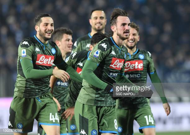 Fabian Ruiz of Napoli celebrates with teammates after scoring the second goal of his team during the Serie A match between Brescia Calcio and SSC...