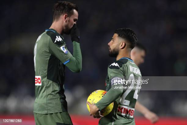 Fabian Ruiz of Napoli exchanges words with Lorenzo Insigne of Napoli before he takes the second half penalty during the Serie A match between Brescia...