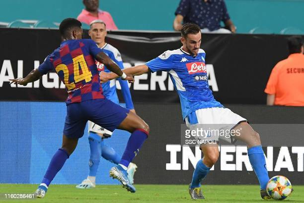 Fabian Ruiz of Napoli kicks the ball during the preseason friendly match between FC Barcelona and SSC Napoli at Hard Rock Stadium on August 7 2019 in...