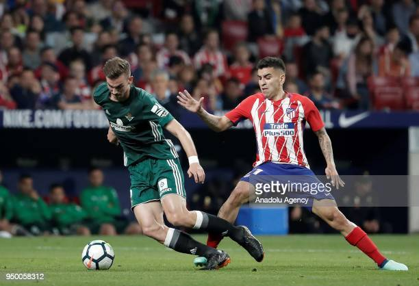 Fabian Ruiz of Real Betis in action against Angel Correa of Atletico Madrid during the La Liga soccer match between Atletico Madrid and Real Betis at...