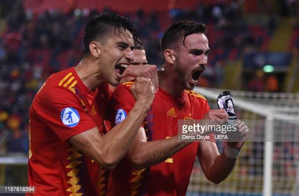Fabian Ruiz of Spain celebrates with Marc Roca after scoring Spain's 3rd goal in the 2019 UEFA U21 Group A match between Spain and Poland at Renato...